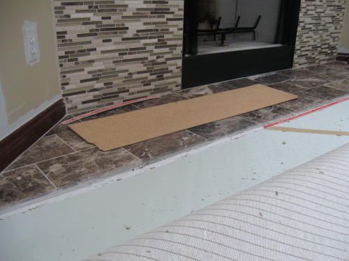 (Loose shim board on tile they come in four foot lengths)